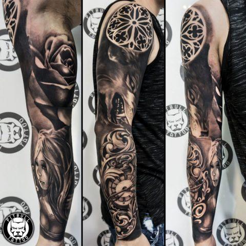 Black and grey arm sleeve tattoo by artist Korn