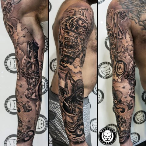 black and grey tattoo by artist Korn